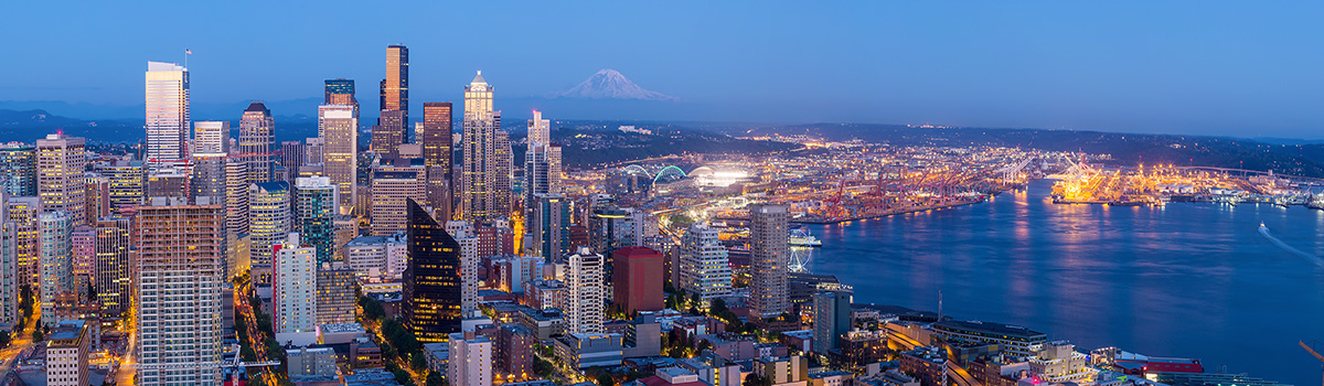 An aerial view of the Seattle skyline as dusk arrives